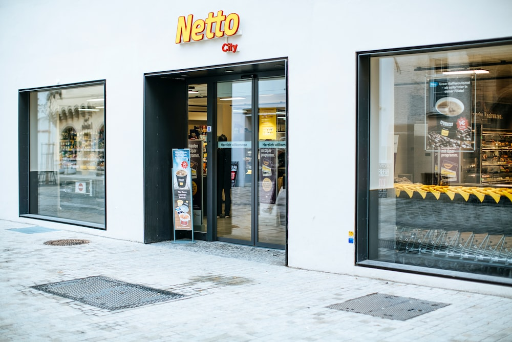 white and black store front during daytime