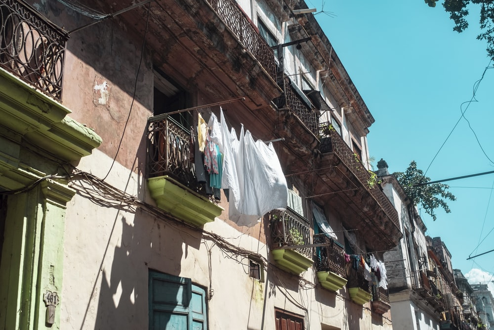 clothes hanged on wire near building during daytime
