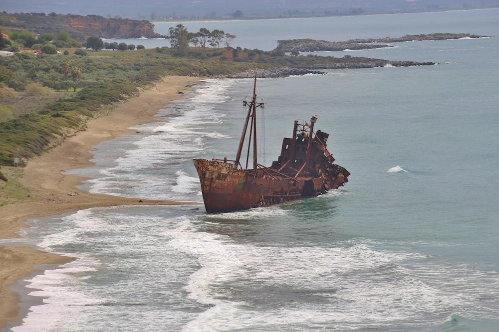 brown ship on sea during daytime