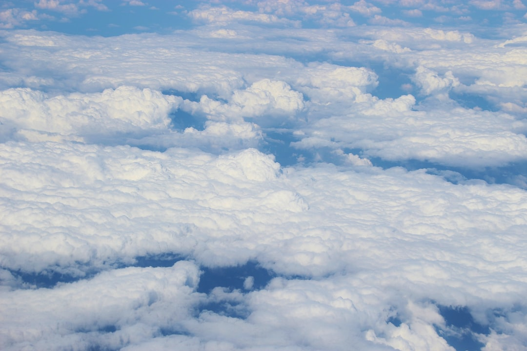 Clouds, seen from above, through the window of an aeroplane. Above Croatia, Europe.