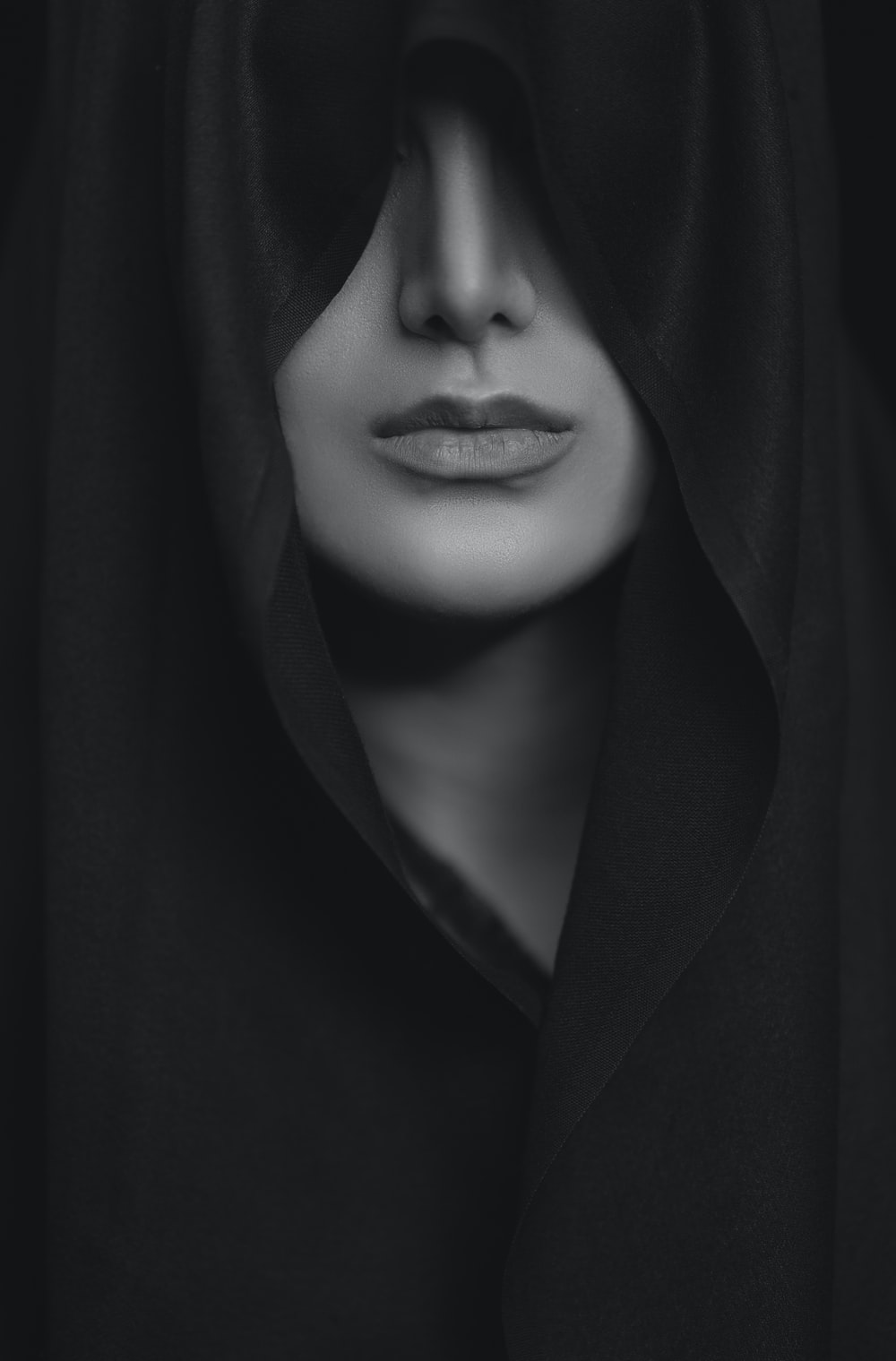 woman in black coat in grayscale photography