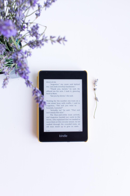 black e book reader on white surface