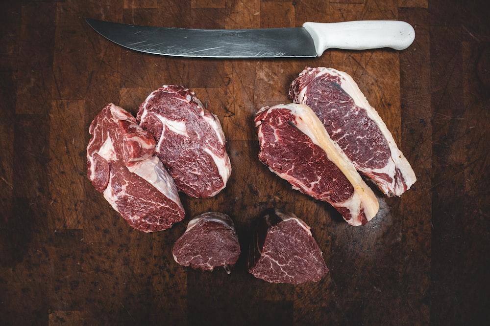sliced meat beside silver knife