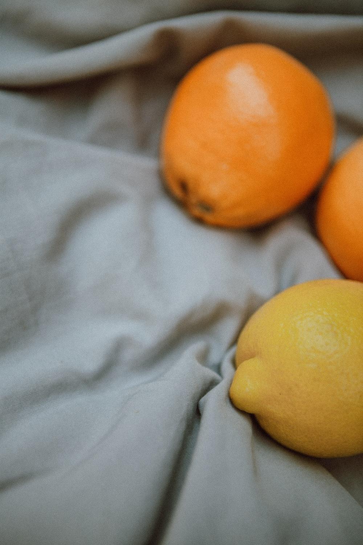 yellow citrus fruit on white textile