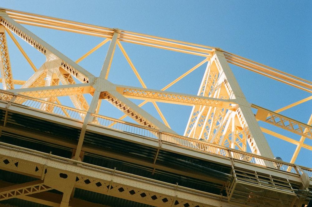 white metal bridge under blue sky during daytime