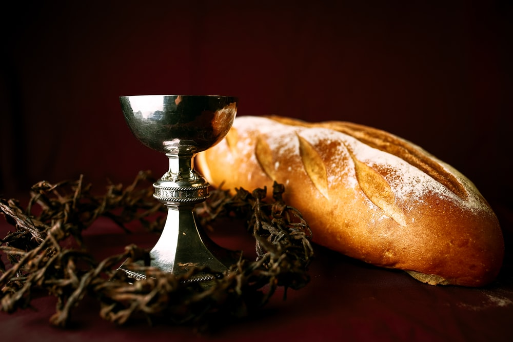 bread on silver stand beside bread