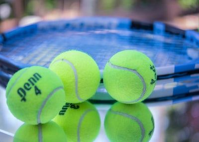 green tennis ball on blue and white net us open tennis zoom background