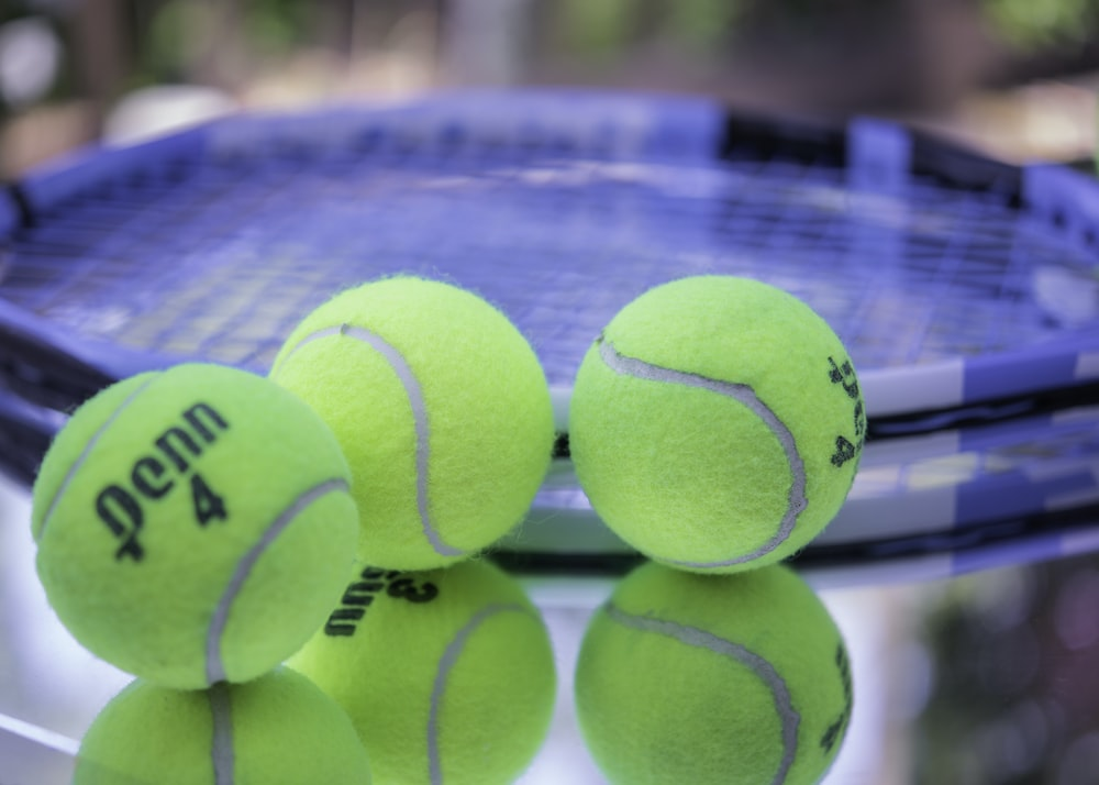 green tennis ball on blue and white net