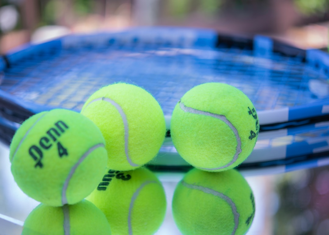 Tennis Balls with racquet close up.