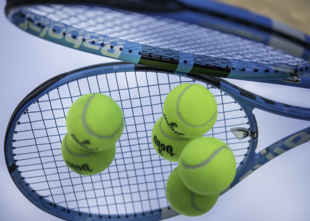 green tennis ball on white net