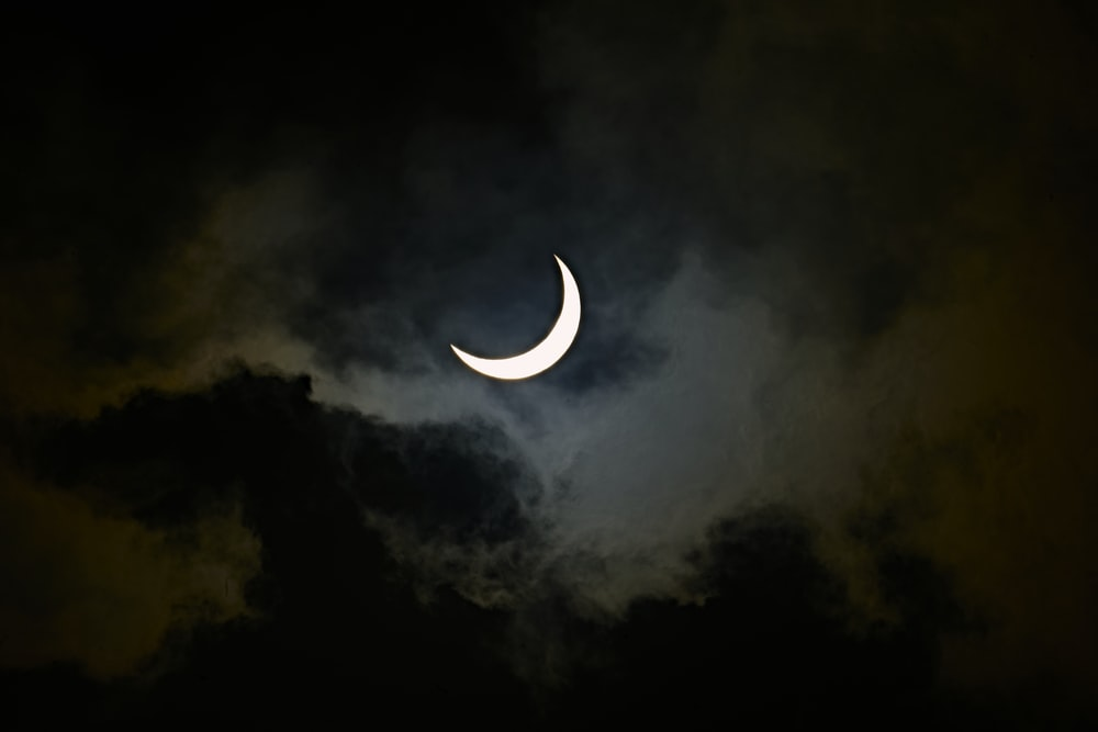 white and black crescent moon