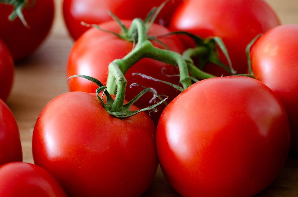 red tomato on white table