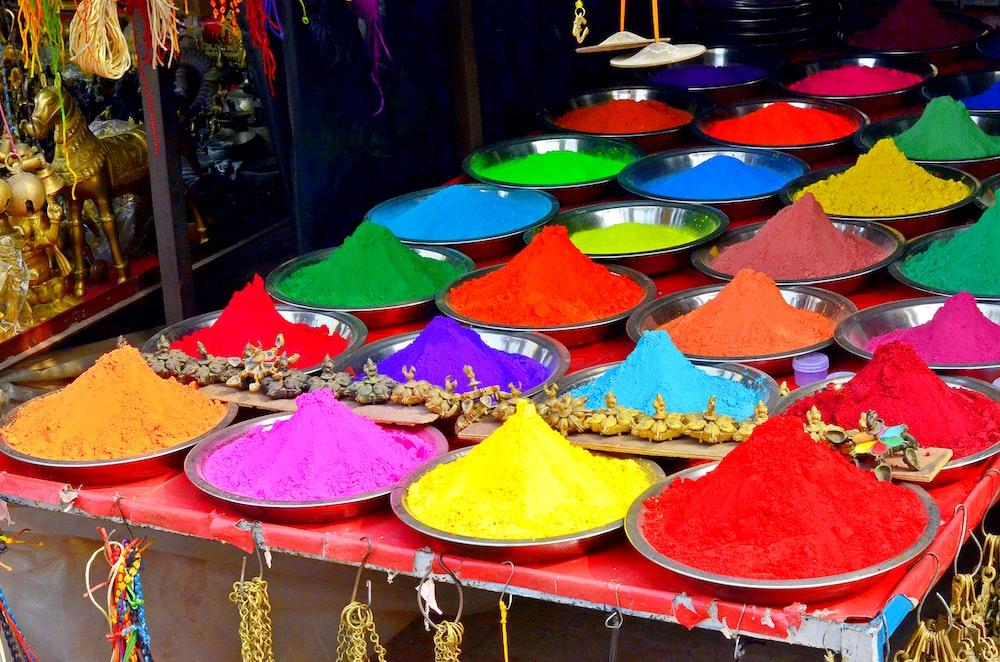 multi colored umbrella on red shelf