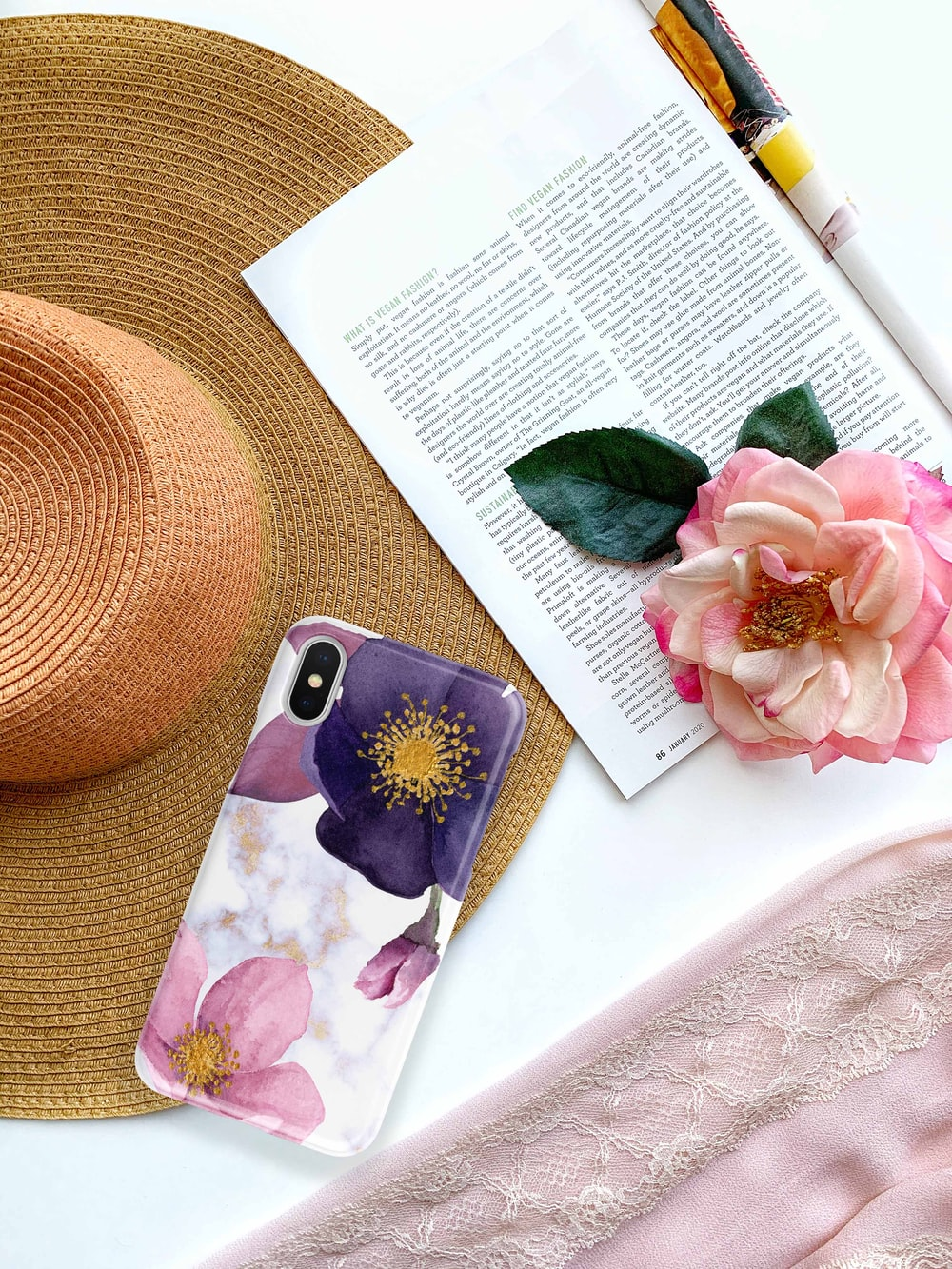 pink and black floral iphone case on book page