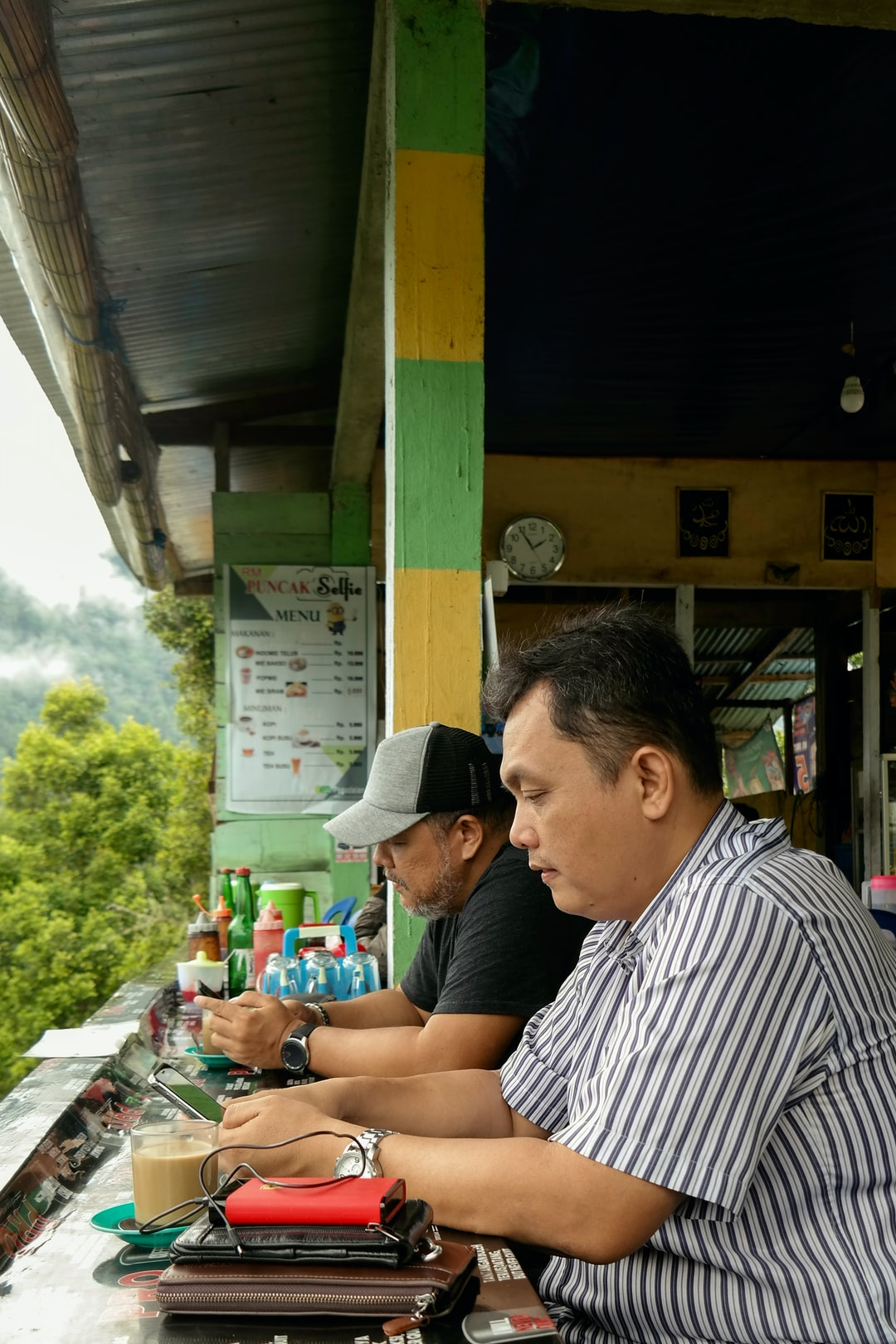 two men with handphone and internet.