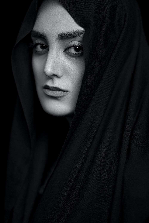 woman in black hijab in grayscale
