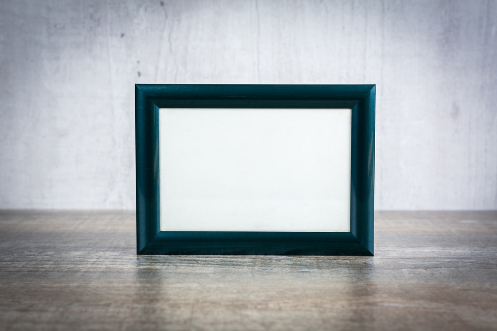 blue wooden frame on brown wooden table