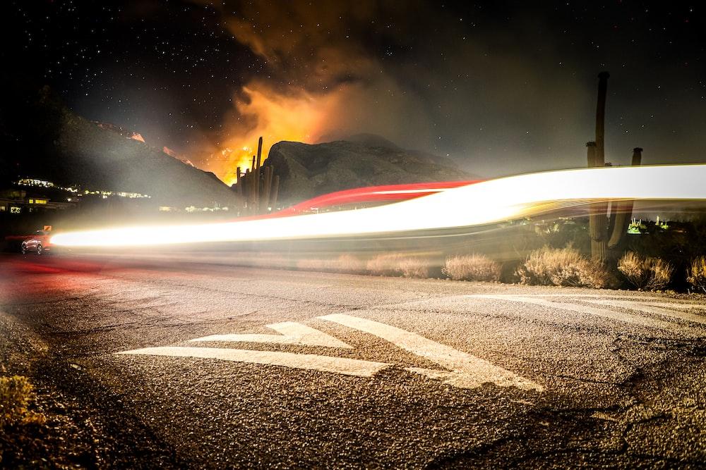 gray asphalt road during night time