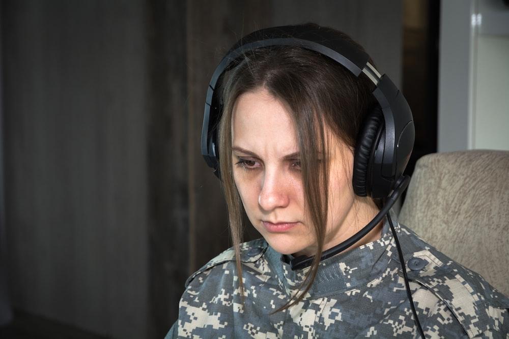 woman in black and grey headphones