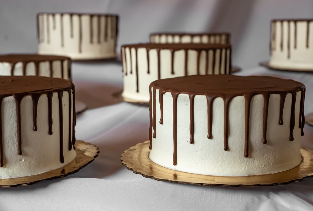 brown and white cake on white table