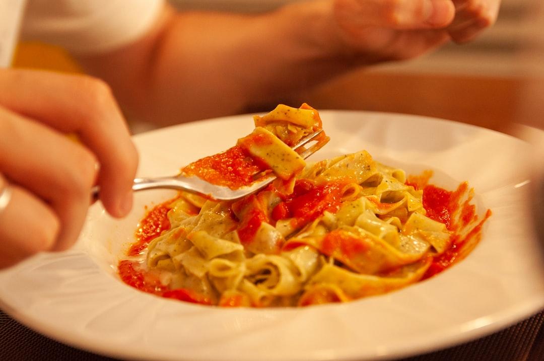 Italian pomodoro and basilico tagliatelle spaghetti.