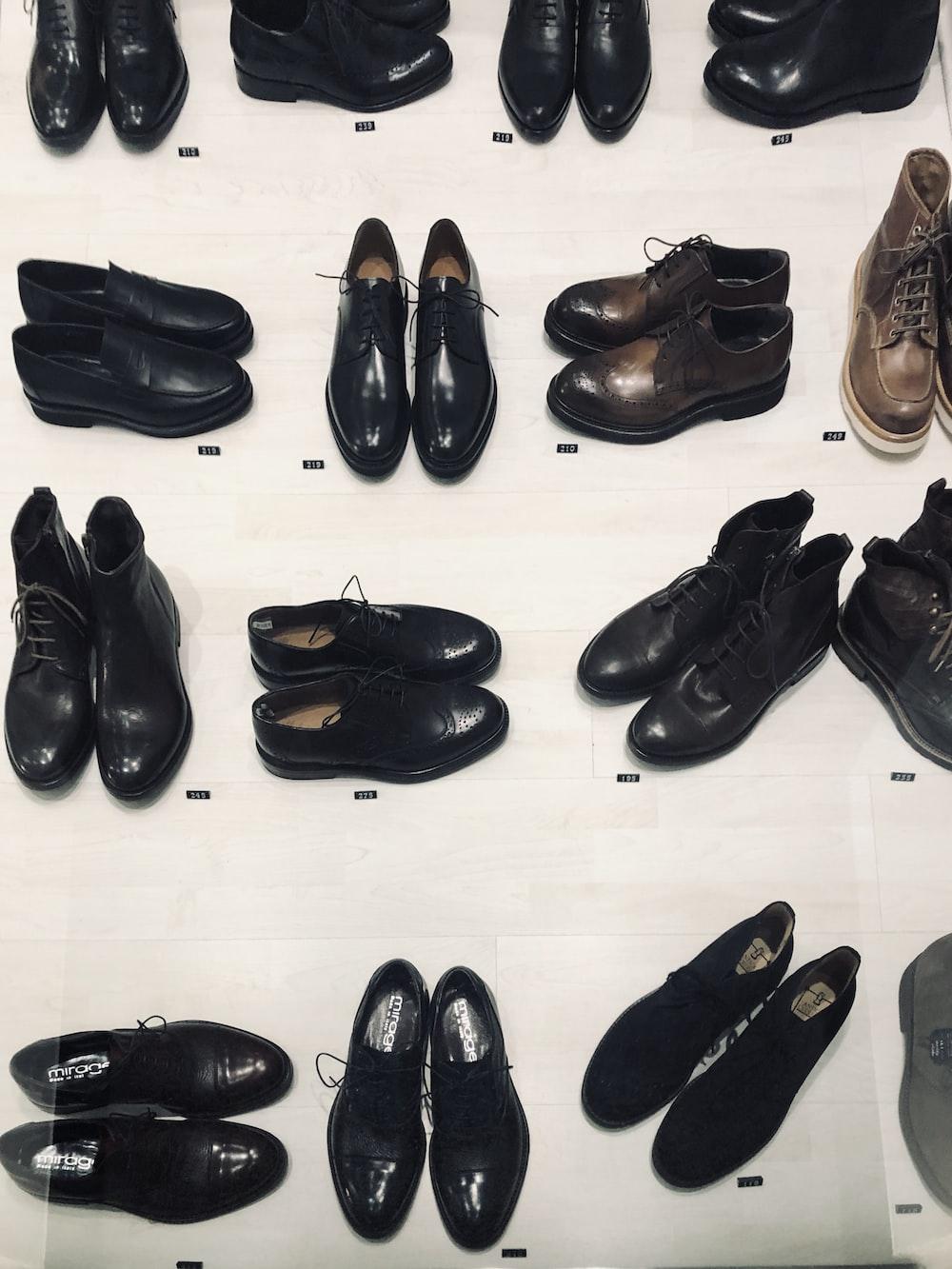 black leather dress shoes on white floor tiles