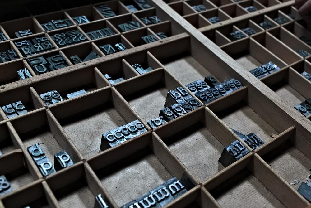 brown wooden cube blocks on brown wooden shelf