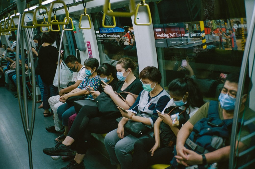 people sitting on train seat