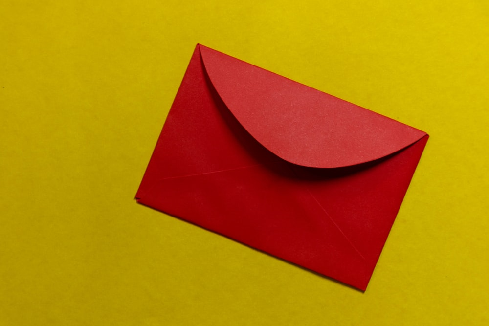 red paper on yellow surface