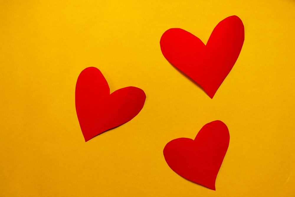 red hearts on yellow paper