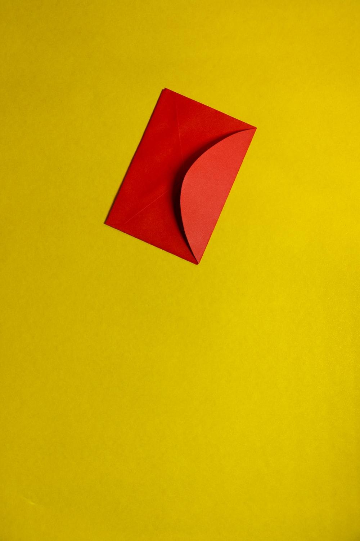 orange paper on yellow surface
