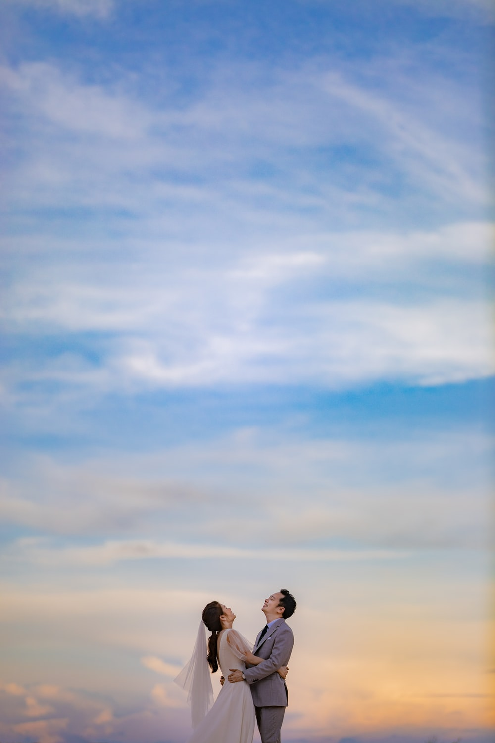 2 person standing under blue sky during daytime