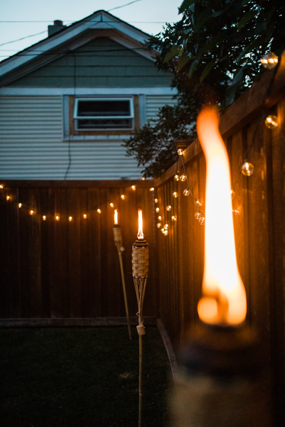 lighted candles on street during night time