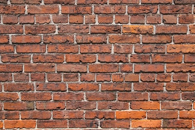 brown and white brick wall brick teams background