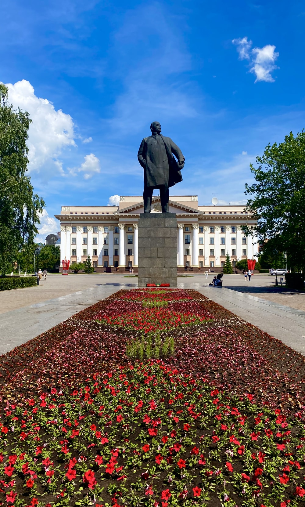 man statue in front of white building