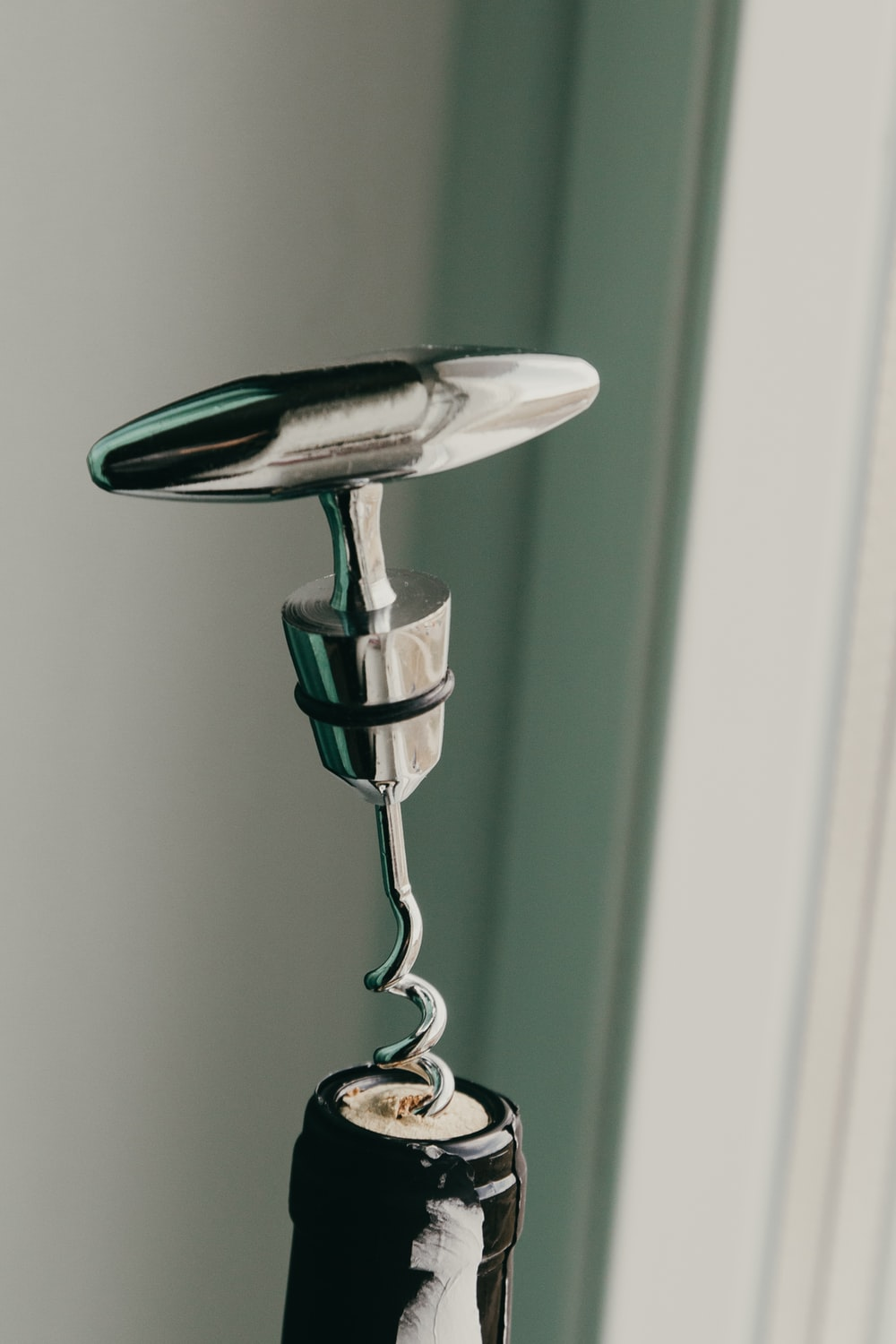 silver and black steel faucet