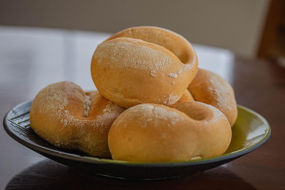 brown bread on black ceramic plate