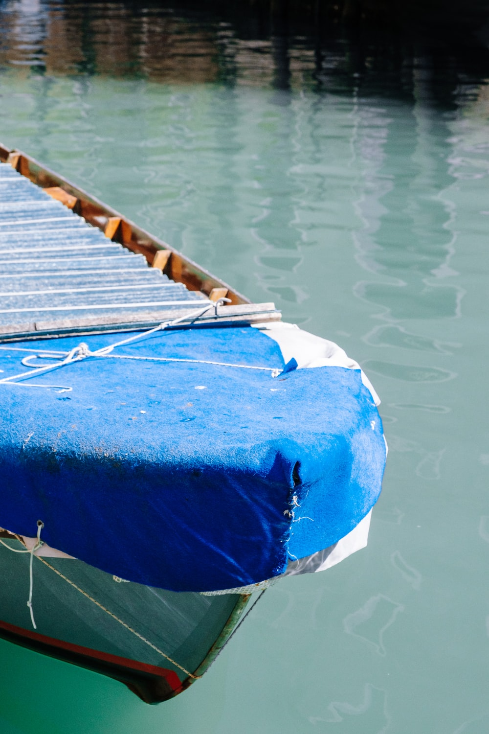blue textile on brown wooden dock