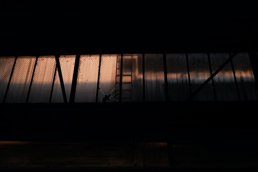 black metal frame on brown wooden floor