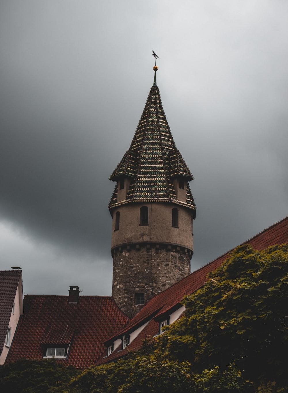 brown brick building under cloudy sky