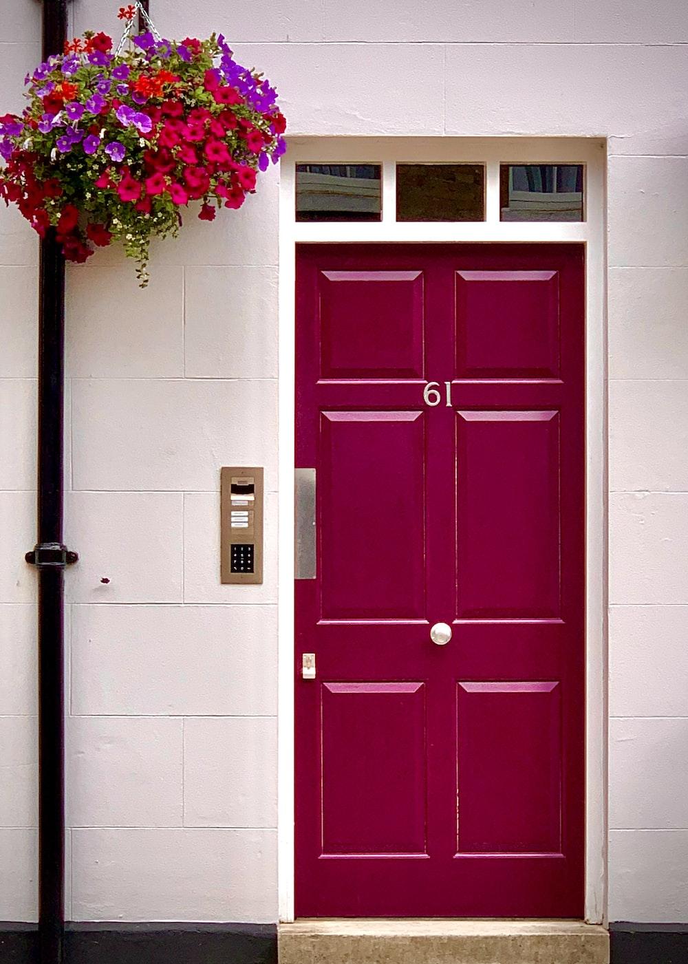 red wooden door with pink flowers