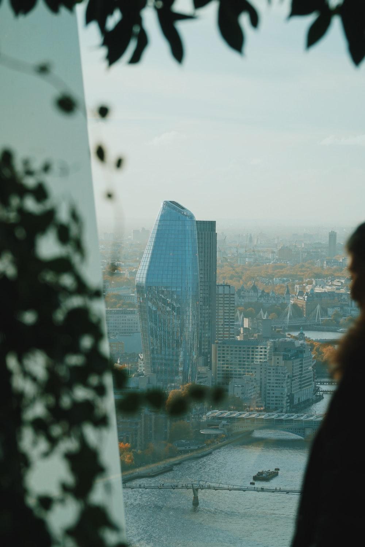 woman in black jacket standing near glass window