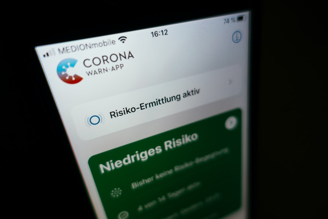"An IPhone running the official German ""Corona-Warn-App"" for tracing Covid-19 infections. The risk analysis is activated."