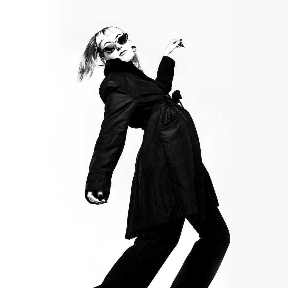 woman in black coat and black pants