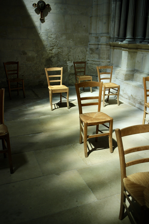 brown wooden chairs on gray floor tiles