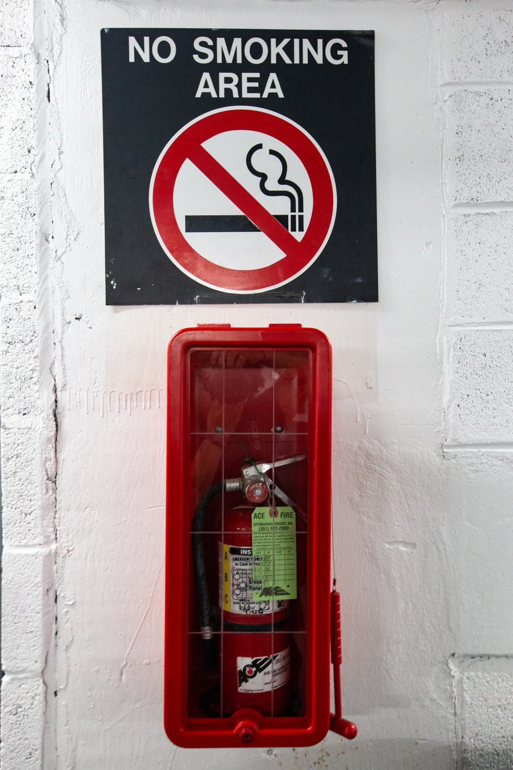 red and white fire extinguisher