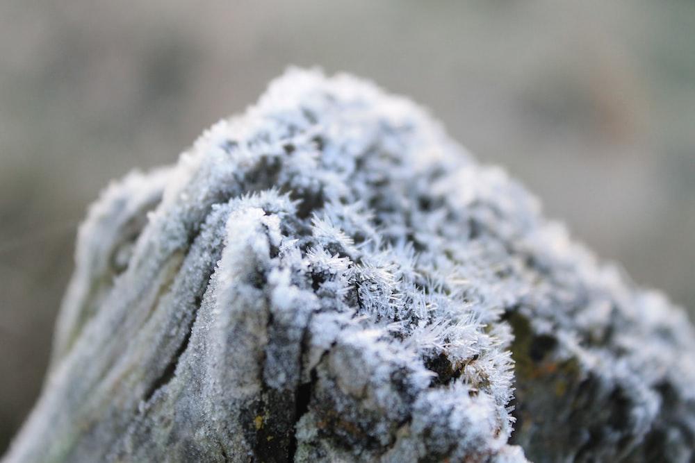 white snow on black rock