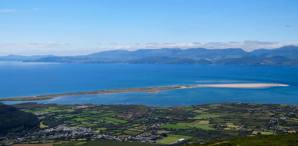 aerial view of green mountains and blue sea during daytime