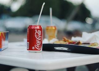 coca cola can on white ceramic plate