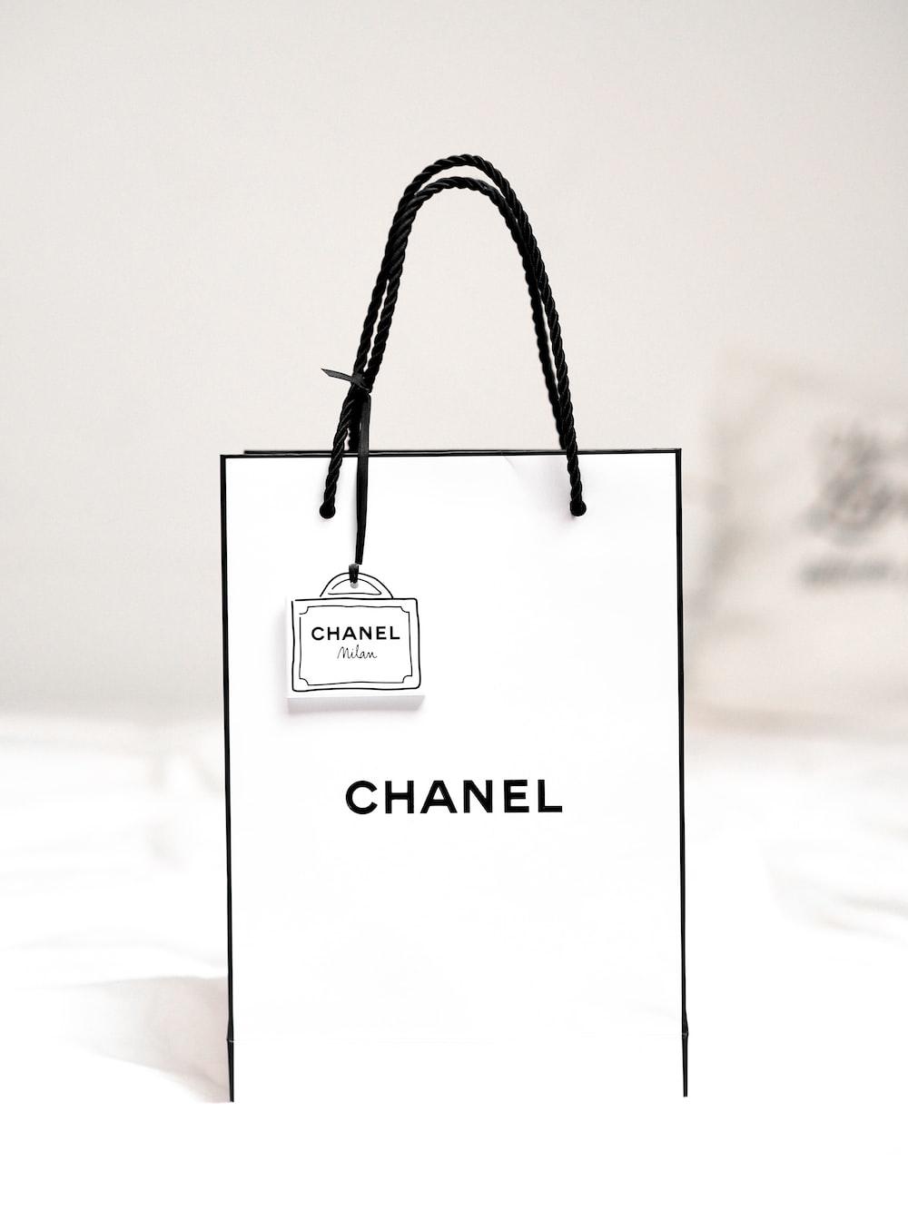 black leather sling bag on white textile